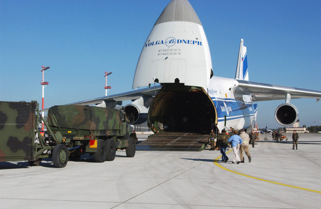 A US Army 212th Mobile Army Surgical Hospital (MASH) M939A2 (6 x 6) 5-ton cargo truck waits to drive up into the open cargo area onboard a Volga-Dnepr Airlines Antonov AN-124-100 Condor cargo aircraft at Ramstein Air Base (AB), Germany (DEU) to be airlifted as part of the lead element of Task Force 212 (TF 212) into Pakistan (PAK) as part of a multinational humanitarian assistance effort in response to the 7.6 magnitude earthquake that hit Kashmir, Pakistan on October 8, 2005