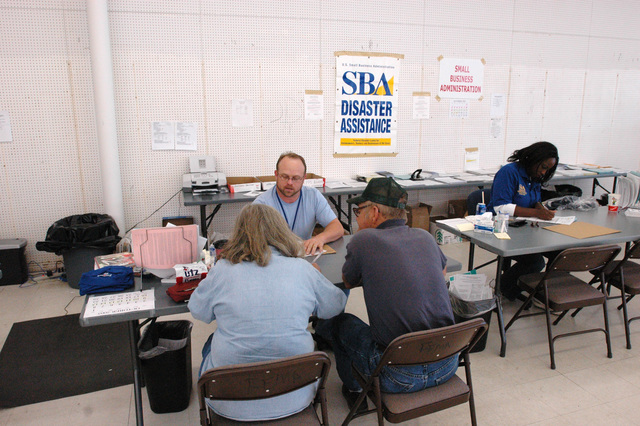 [Hurricane Katrina] Wiggins, Miss., October 9, 2005 -- A Small Business Administration (SBA) representative help residents at the Wiggins Disaster Recovery Center (DRC).  DRCs are placed in communities to help residents with the FEMA recovery process.  FEMA/Mark Wolfe