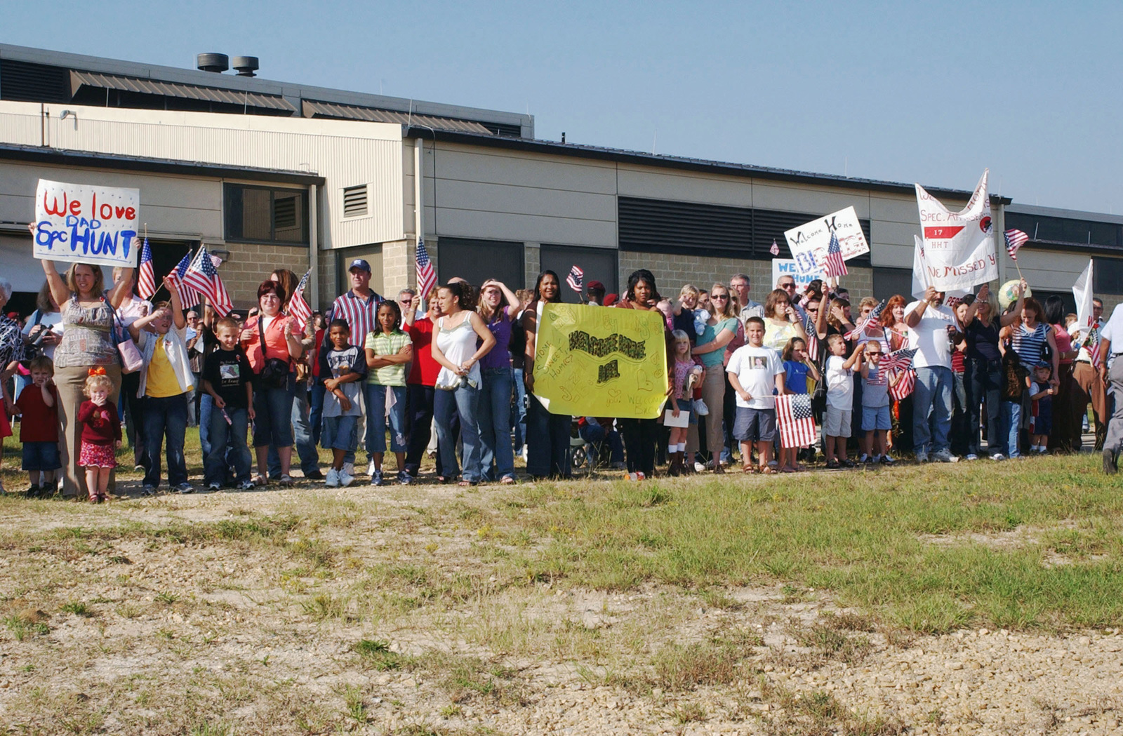 Friends and family members of the redeploying 1ST Squadron, 17th Cavalry Regiment (1/17th CAV), 82nd Airborne Division (ABN), gather near the flight line at the Green Ramp, Pope Air Force Base (AFB), North Carolina (NC), as the wait for their loved ones to disembark after their deployment to northern and central Iraq (IRQ) in support of Operation IRAQI FREEDOM