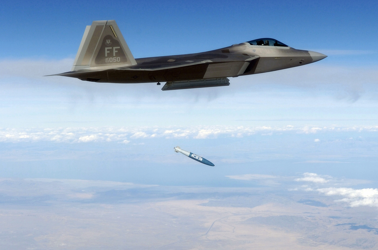 U.S. Air Force LT. COL. Wade Tolliver, Pilot, F/A-22 Raptor, and Director of Operations, 27th Fighter Squadron, Langley Air Force Base, Va., releases a 1,000 lb. GBU-32 Joint Direct Attack Munition (JDAM) over the Utah Test and Training Range, Hill Air Force Base, Oct. 20, 2005, during the Combat Hammer Air-to-Ground Weapons System Evaluation Program hosted by the 86th Fighter Weapons Squadron, Elgin Air Force Base, Fla. (U.S. Air Force photo by MASTER SGT. Michael Ammons) (Released)
