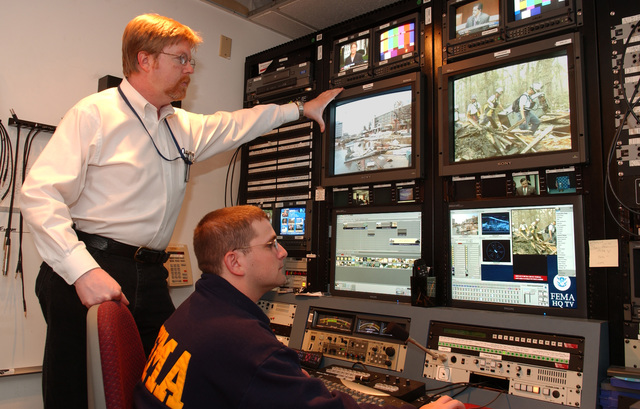 Washington, DC, October 20, 2005 -- Paul Luke and Aaron Skolnik, video production specialists at the FEMA headquarters video production facility.  Bill Koplitz/FEMA