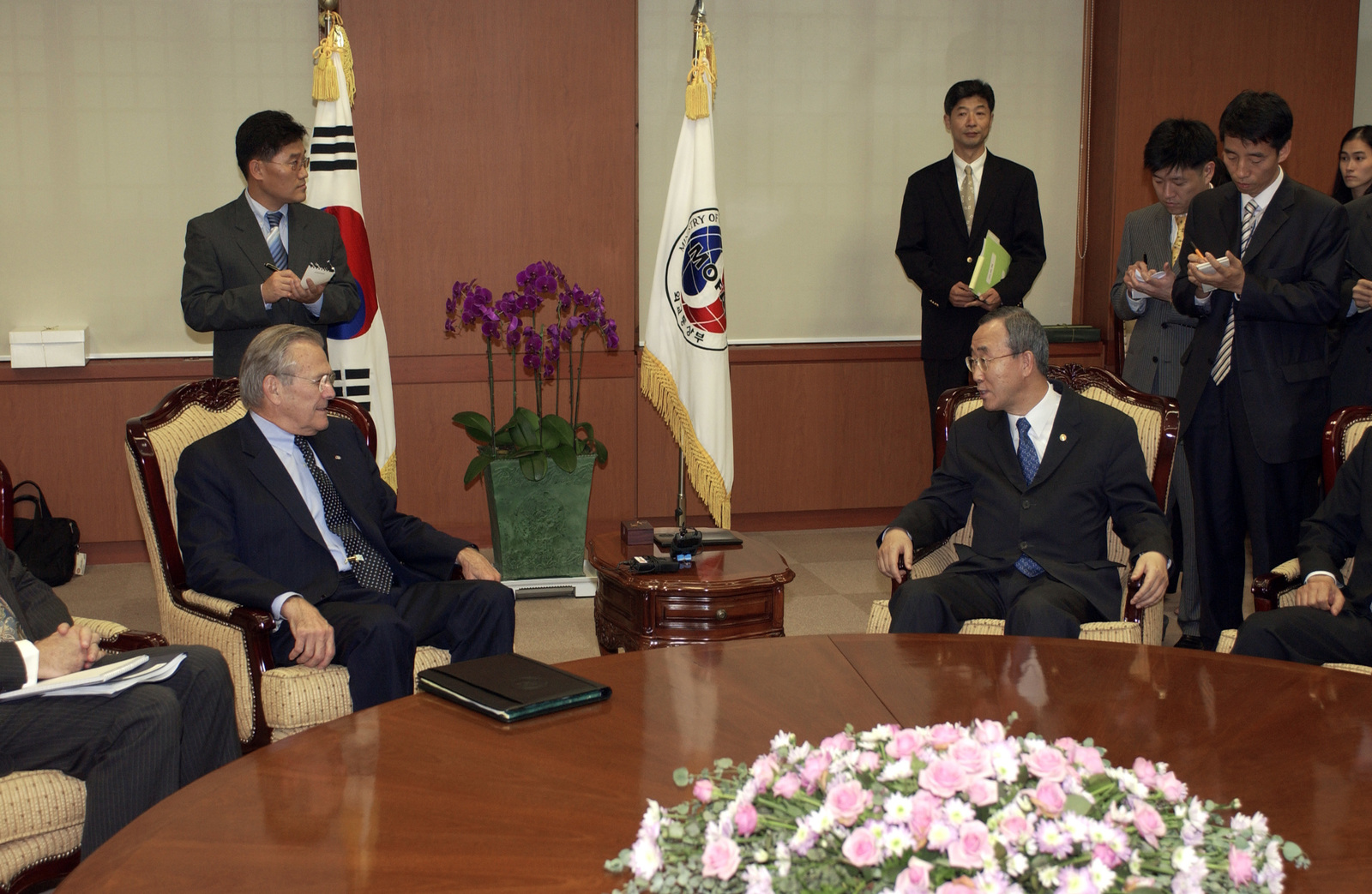 The Honorable Donald H. Rumsfeld (seated fourth from left), U.S. Secretary of Defense, speaks with the Honorable Ban Ki Moon (seated third from right), Minister of Foreign Affairs for the Republic of Korea, while in Seoul, Seoul National Capital Area, Republic of Korea, on Oct. 21, 2005. Secretary Rumsfeld is visiting Korea to meet with the Honorable Yoon Kwang Ung, Minister of Defense for the Republic of Korea and to conduct the 37th United States and Republic of Korea Security Consultative Meeting to discuss defense policy issues and the future of U.S. and Korean alliance. (DoD photo by MASTER SGT. James M. Bowman) (Released)