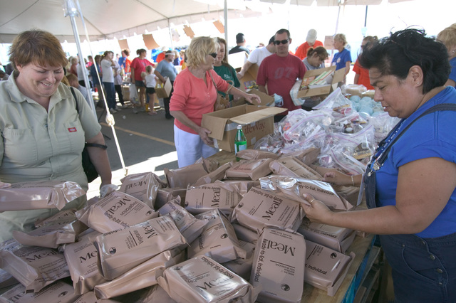 [Hurricane Katrina] New Orleans, LA., 10/22/2005 -- Volunteer, Linda Henson assists Janet Fontenot with the distribution of food and necessities at the Chalmette Recovery Center following devastating hurricane Katrina.  FEMA photo/Andrea Booher