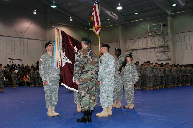 US Army (USA) Colonel (COL) James A. Polo (far left), Commander, 47th Combat Support Hospital (CSH); USA Sergeant Major (SGM) Amin Arreola (legs behind unit colors), Command Sergeant Major (CSM), 47th CSH; USA Lieutenant General (LGEN) James M. Dubik (left, back to camera), Commanding General (CG), I Corps and Fort Lewis; and USA SGM Tommy A. Williams (right, back to camera), CSM, I Corps and Fort Lewis; participate in furling and casing the 47th CSH unit colors during the 47th CSH Deployment Ceremony, held in Wilson Gym, Fort Lewis, Washington (WA). This is the second time that the 47th CSH is being deployed to Iraq (IRQ) to support Operation IRAQI FREEDOM