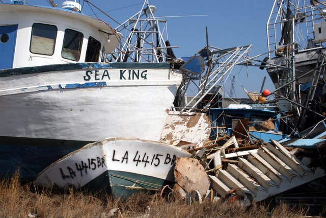 [Hurricane Katrina] Empire, LA, October 25, 2005 - Fishing boats are stacked on top of other boats in Empire, LA, a result of Hurricane Katrina's landfall.  This fishing community has extensive damage.  Robert Kaufmann/FEMA
