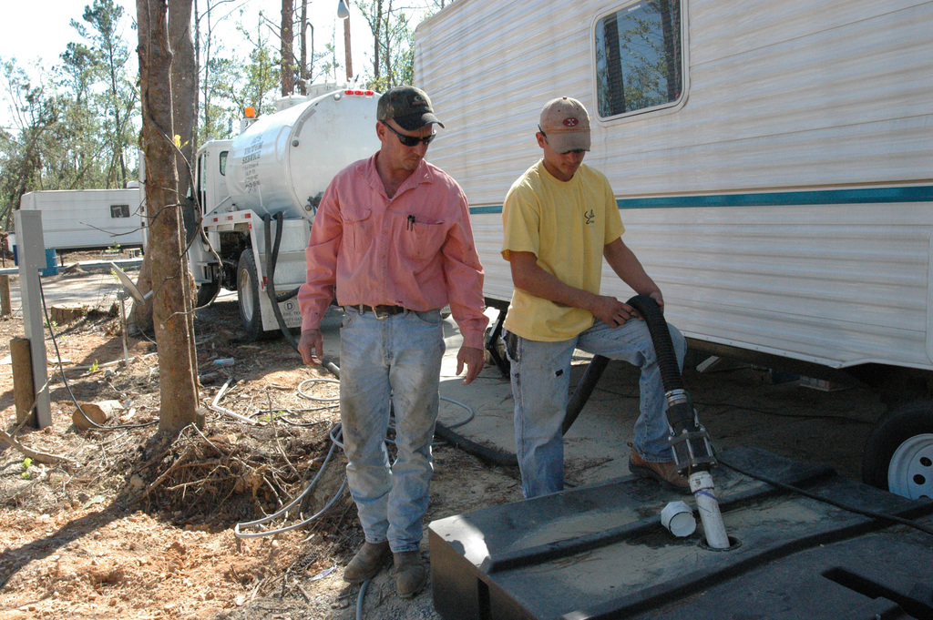 [Hurricane Katrina] Hancock County, Miss., October 26, 2005 -- Workers clean the bladder of a travel trailer in McLeod Park.  It is important that the FEMA travel trailers are well maintained and kept functioning correctly.  FEMA/Mark Wolfe