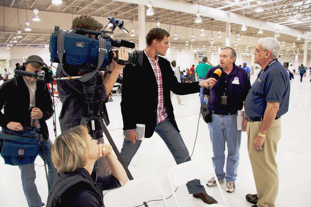 [Hurricane Rita] Houston, TX, October 27, 2005 - Armin Goerper of ZDF German Television, interviews Charley Henderson, Public Information Officer (PIO) lead, and Paul Ferris, a manager of the super Disaster Recovery Center (DRC).  Producer Annette Brieger looks on.  International media is managed by FEMA PIOs.  Photo by Ed Edahl, FEMA