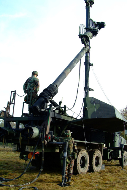 C Battery 5th Battalion 7th Air Defense Artillery, C BTRY 5/7 ADA, Oct. 28, 2005 at the Hohe Warta Training Area near Giessen, Germany. Soldier prepares the communication antenna for movement back to their home station as this two week exercise to complete table 12 evaluation comes to a close. Table 12 involves coordinated movement of the battalions assets while in MOPP 4 at night. (U.S. Army photo by Martin Greeson) (Released)