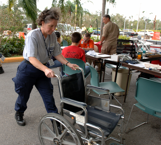 [Hurricane Wilma] Boynton Beach, FL, October 29, 2005 -- A FEMA Disaster Medical Assistance Team member returns a wheelchair at the JFK Medical Center.  The DMAT is set up in the entry way of the hospital to assist in seeing the increase flow of patients due to Hurricane Wilma.  Jocelyn Augustino/FEMA