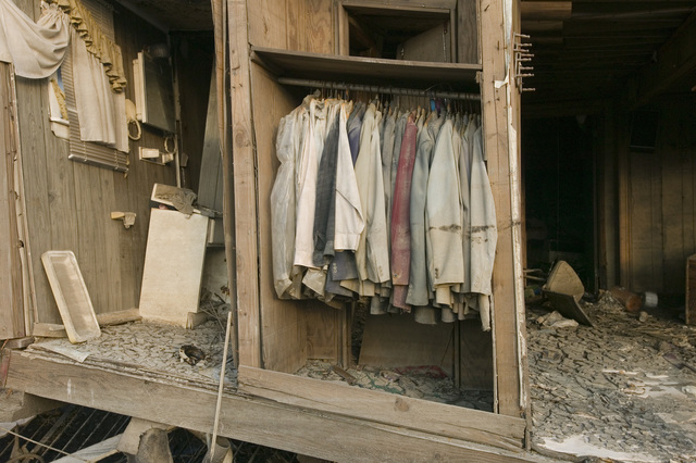 [Hurricane Katrina] New Orleans, LA., 11/01/2005 -- A closet with suits hanging exposed to the outside elements at a home that was destroyed in the Lower 9th Ward due to Hurricane Katrina.  Andrea Booher/FEMA