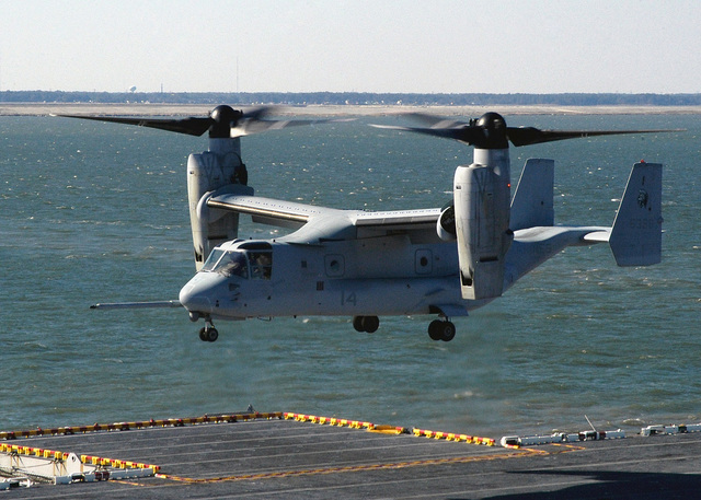 A US Marine Corps (USMC) MV-22 Osprey, Marine Tiltrotor Operational Test and Evaluation Squadron 22 (VMX-22), prepares to land on the flight deck of the US Navy (USN) Amphibious Assault Ship USS WASP (LHD 1). The WASP, homeported at Naval Station (NS) Norfolk, is conducting port familiarization operations in anticipation of an upcoming underway training period with the USMC MV-22 Osprey. The MV-22 is an advanced technology, vertical/short takeoff and landing (VSTOL) multipurpose tactical aircraft, and scheduled to replace the aging CH-46E Sea Knight and CH-53D Sea Stallion helicopters currently in service