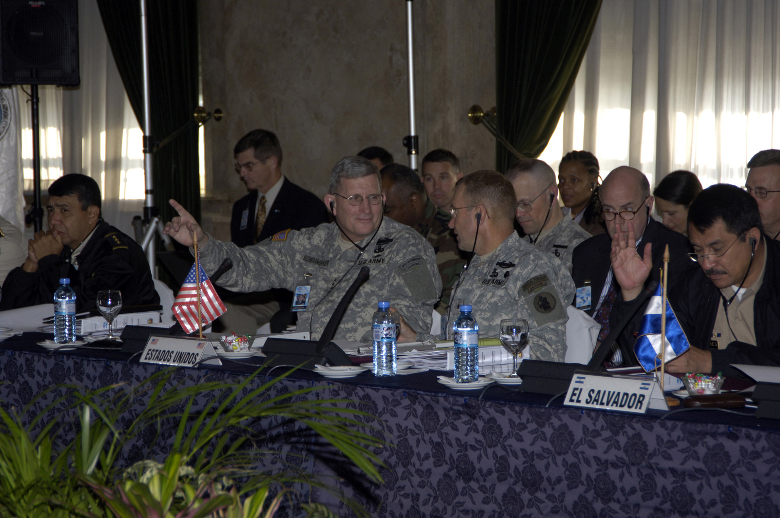"GEN. Peter A. Schoomaker, CHIEF of STAFF, U.S. Army, center left, raises his hand in a""yea""vote while talking with U.S. Army South Commanding General Brig. GEN. Purl K. Keen, right, during the Conference of American Armies Commander's Conference in Buenos Aires, Argentina on Nov. 3, 2005. (U.S. Army photo by Kaye Richey) (Released)"