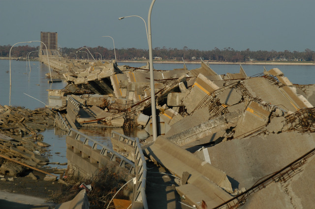 [Hurricane Katrina] Biloxi, Miss., November 3, 2005 -- The Hwy 90 bridge from Biloxi to Ocean Springs lies in a twisted mass as result of catastrophic wind and storm surge from Hurricane Katrina.  Road closure along the coastal area has complicated recovery efforts.  George Armstrong/FEMA
