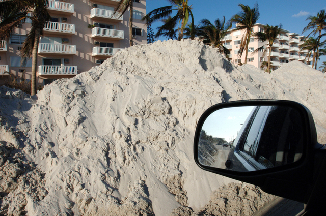 [Hurricane Wilma] Key West, FL, November 4, 2005 -- Mounds of sand piled in the street.  The sand covered the street as a result of Hurricane Wilma and city workers are trying to put it back in it's place.  Jocelyn Augustino/FEMA