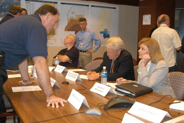 [Hurricane Katrina] Jackson, Miss., November 7, 2005 -- FEMA Deputy Federal Coordinating Officer (DFCO) James N. Russo discusses FEMA and MEMA joint relief efforts for those impacted by Hurricane Katrina, with Governor Haley R. Barbour's wife who is acting as the Governor's representative at the Joint Strategy Meeting at the Jackson FEMA Joint Field Office (JFO).  George Armstrong/FEMA