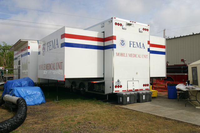 [Hurricane Katrina] Plaquemines Parish, LA  November 7, 2005 - The National Disaster Medical System (NDMS) set up one of the new, innovative, fully self-contained Mobile Medical Units along Route 23 to treat persons who lost access to medical care when hurricanes Katrina and Rita slammed the area.  The MMU is a complete mini-hospital.  Photo by Greg Henshall / FEMA