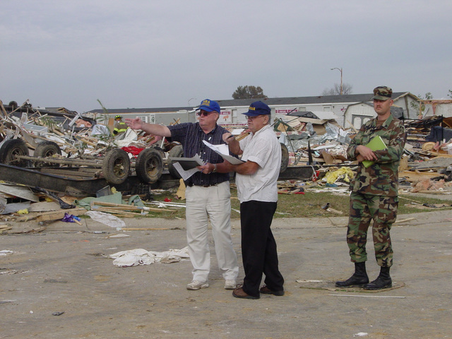 Vanderbergh County, IN, November 7, 2005 -- Disaster recovery workers assess the damage to the Eastbrook Mobile Home Park in Vanderburgh County, IN, which took the direct hit from the tornado.  Those assessing damage are Donald Quirim (FEMA) center, Christopher Lamer (SBA) left , and Sgt. First Class Donald Tabor (IN National Guard) right.  Gay Ruby/FEMA