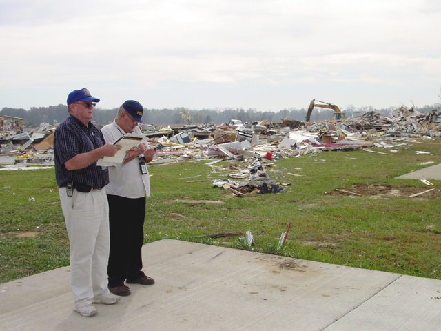 Vanderbergh County, IN, November 7, 2005 -- Disaster recovery workers assess the damage to the Eastbrook Mobile Home Park in Vanderburgh County, IN which took the direct hit from the tornado.  Those assessing damage are Donald Quirim (FEMA) right and Christopher Lamer (SBA) left .  Gay Ruby/FEMA