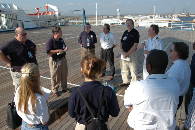 [Hurricane Katrina] Pascagoula, Miss., November 8, 2005 -- FEMA, MEMA and Carnival Cruise Line representatives show local officials around the cruise ship Holiday.  The cruise ship is being used to house Mississippi residents displaced from their homes by Hurricane Katrina.  FEMA/Mark Wolfe