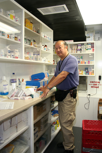 [Hurricane Katrina] Plaquemines Parish, LA,  November 7, 2005 -- Pharmacist Irwin Chow organized a new shipment of medical supplies in the new and innovative Mobile Medical Unit FEMA set up in the hurricane-ravaged area of soutern Louisiana.  Local residents who lost access to medical care can get comprehensive treatment at the MMU.  Photo by Greg Henshall / FEMA