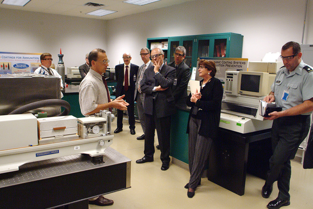 Major Gen. Roger A Nadeau, Commanding General, U.S. Army Research, Development and Engineering Command, hosts a Directors meeting at the Rodman Materials Research Facility. During the briefing, one of the topics the instructor discusses is coatings for ammunition as the guest look on. At the conclusion of the meeting, a tour of the facility was conducted by Army Research Lab scientists and engineers. (U.S. Army PHOTO by Doug LaFon) (Released)