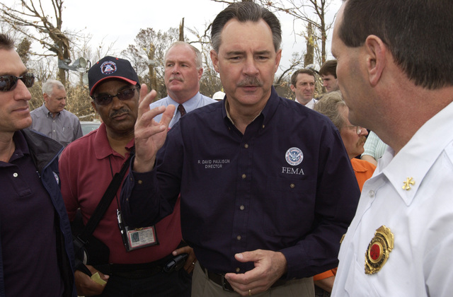 [Tornado and Severe Storms] Evansville, IN, November 9, 2005 -- Acting FEMA Director R. David Paulison touring tornado ravaged Evansville and Newberg, Indiana. Paulison praising local community effort. Federal Coordinating Officer (FCO), Brad Gair (left).  Leif Skoogfors/FEMA Photo