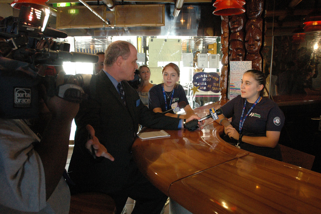 [Hurricane Katrina] Pascagoula, Miss., November 10, 2005 -- Americorps volunteers (right) get interviewed by the local television media aboard the cruise ship Holiday.  Many different agencies are helping out on the cruise ship which is being used to house Mississippi residents displaced from their homes by Hurricane Katrina.  FEMA/Mark Wolfe