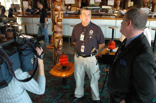 [Hurricane Katrina] Pascagoula, Miss., November 10, 2005 -- FEMA representative Herve Riou (center) is interviewed by the local television station aboard the cruise ship Holiday.  The cruise ship is being used to house Mississippi residents displaced from their homes by Hurricane Katrina.  FEMA/Mark Wolfe