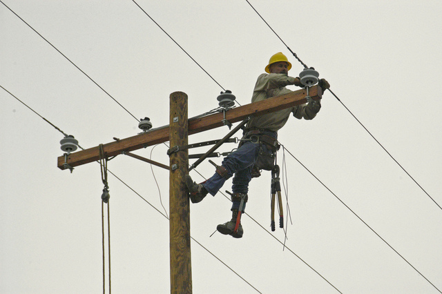 [Hurricane Rita] Cameron, LA, 11-10-05 -- Lineman Marion Chappell from Utah repairs a damaged power line from Hurricane Rita.  FEMA is helping Local governments get Roads, Bridges, and Utilities back in operation so residents can move back.  MARVIN NAUMAN/FEMA photo