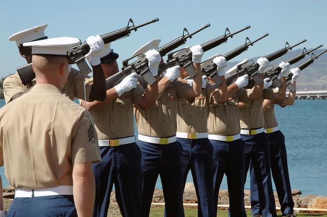 A US Marine Corps (USMC) rifle detail from Marine Corps Base (MCB) Hawaii, Kaneohe, Hawaii (HI), fire a 21-gun salute with 5.56 mm M16A2 rifles during a ceremony dedicating a new flagstaff and display of bronze plaques commemorating the 73 Marines who gave their lives and the 15 survivors of the attack on the US Navy (USN) battleship USS ARIZONA at Pearl Harbor, HI, on December 7, 1941. The memorial features the names of the 88 Marines stationed aboard ARIZONA during the attack, a piece of steam pipe from the ARIZONA's original hull, the National ENSIGN, and the US Navy and Marine Corps flags