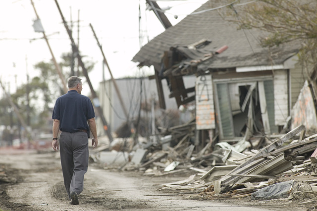 [Hurricane Katrina] New Orleans, LA,,11/16/2005-- FEMA Deputy Federal Coordinating Officer, Ted Monette walking on a street piled high with debris and rubble from destroyed homes and properties in the Lower 9th Ward caused by Hurricane Katrina.  Andrea Booher/FEMA