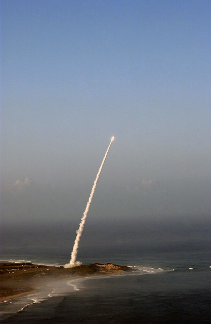 """A medium-range separating target missile is seen seconds after lift-off from the Pacific Missile Range Facility (PMRF), Barking Sands, Kauai, Hawaii (HI). Six minutes later, the target was intercepted by a developmental Standard Missile Three (SM-3) launched from the Pearl Harbor based Ticonderoga Class Guided Missile Cruiser USS LAKE ERIE (CG 70) [not shown]. The test was the sixth intercept, in seven ight tests, by the AEGIS (Airborne Early-Warning Ground-Environmental Integration Segment) Ballistic Missile Defense, the maritime component of the """"Hit to Kill"""" Ballistic Missile Defense System, being developed by the Missile Defense Agency. All previous Aegis Ballistic Missile Defense..."""