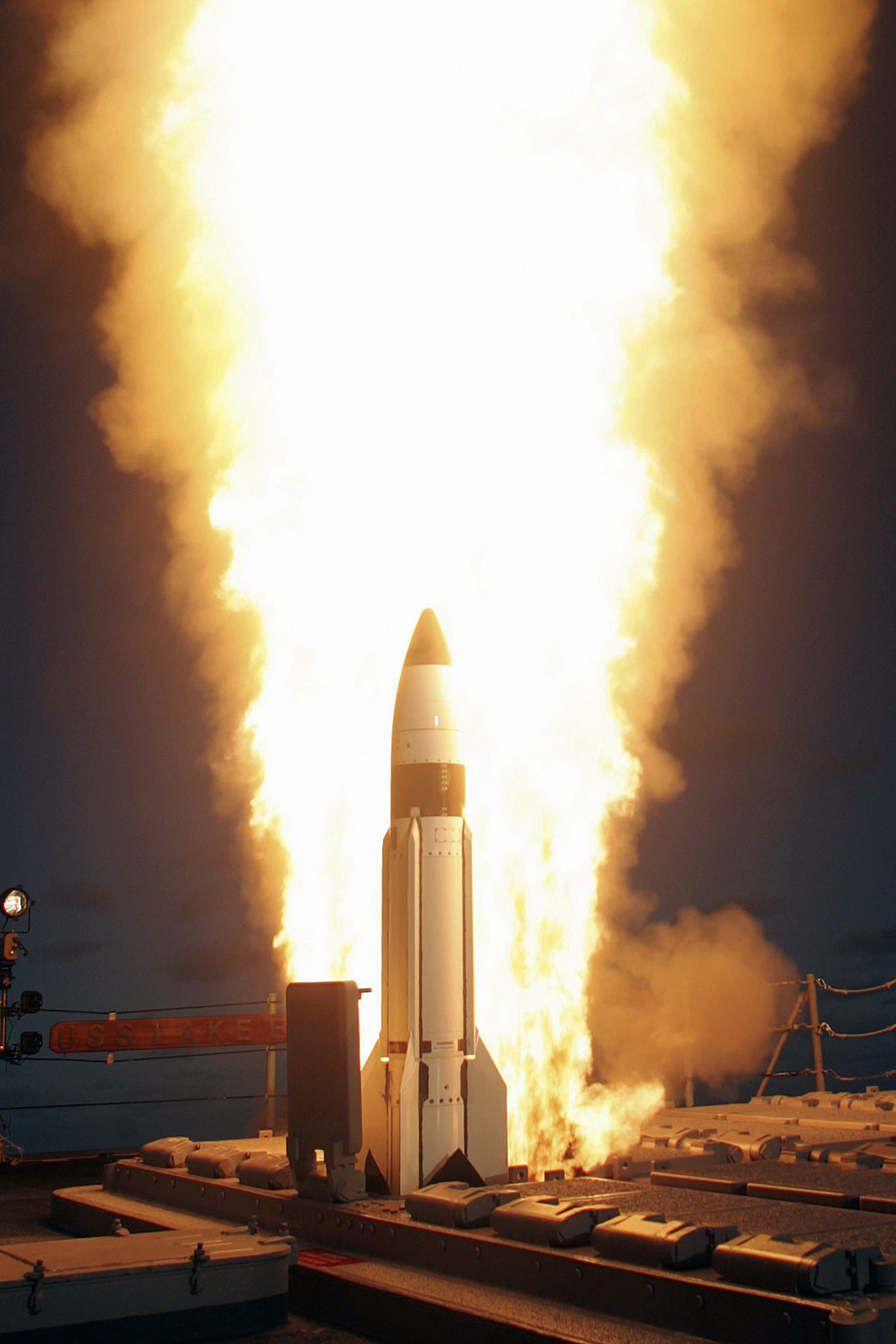 """A US Navy (USN) Standard Three (SM-3) is launched from the vertical launch system (VLS) aboard the Pearl Harbor based Ticonderoga Class Guided Cruiser USS LAKE ERIE (CG 70), during a joint Defense Agency, USN ballistic missile flight test. Minutes later, the SM-3 intercepted a separating ballistic missile threat target, launched form the Pacific Range Facility, Barking Sands, Kauai, Hawaii. The test was the sixth intercept, in seven flight tests, by the AEGIS (Airborne Early-Warning Ground-Environmental Integration Segment) Ballistic Defense, the maritime component of the """"Hit to Kill"""" Ballistic Defense System, being developed by the..."""
