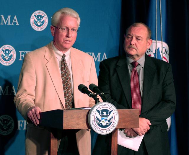 [Hurricane Katrina] Washington, DC, November 17, 2005 -- Dave Garratt, FEMA's Acting Director of Recovery speaks at a press converence at FEMA headquarters on housing for hurricane victims.  US Coast Guard Vice Admiral Thad Allen, who is the Principal Federal Officer for Gulf Coast Hurricane Relief, stands beside him.  Bill Koplitz/FEMA
