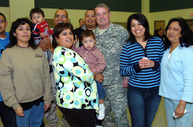 US Army (USA) Brigadier General (BGEN) Robert V. Taylor (center), Assistant Adjutant General, poses for a group photograph with the family members USA Sergeant First Class (SFC), Lorenzo Castilla, a member of the 263rd Personnel Services Detachment, Michigan Army National Guard (MIARNG), at Lansing, Michigan (MI), during a Welcome Home Ceremony for Soldiers returning from a one-year deployment to Iraq, in support of Operation IRAQI FREEDOM. (A3695)