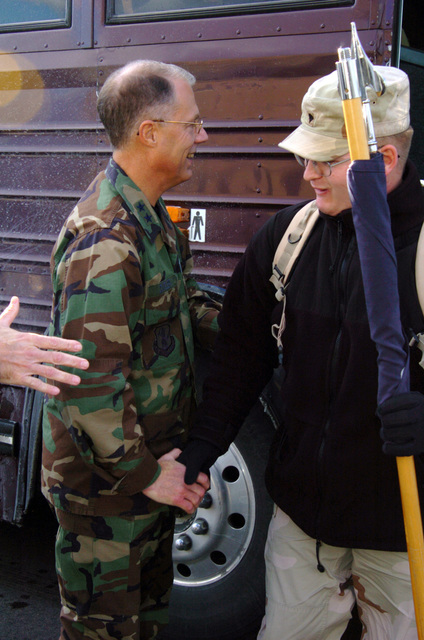US Army (USA) Major General (MGEN) Thomas Cutler (left), Michigan State Adjutant General, welcomes home a USA Specialists (SPC) from the 263rd Personnel Services Detachment, Michigan Army National Guard (MIARNG), as he arrives home at Lansing, Michigan (MI), from a one-year deployment to Iraq, in support of Operation IRAQI FREEDOM. (A3695)