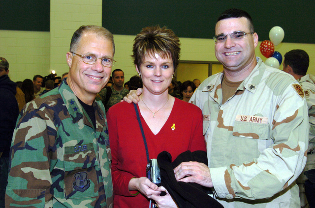 US Army (USA) Major General (MGEN) Thomas Cutler (left), Michigan State Adjutant General, poses for a group photograph with USA Sergeant (SGT) and Mrs. Charles Murphy, during a Welcome Home Ceremony, for Soldiers assigned to the 263rd Personnel Services Detachment, Michigan Army National Guard (MIARNG), at Lansing, Michigan (MI). The Soldiers are returning from a one-year deployment to Iraq, in support of Operation IRAQI FREEDOM. (A3695)