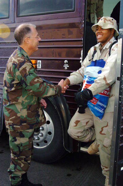 US Army (USA) Major General (MGEN) Thomas Cutler (left), Michigan State Adjutant General, welcomes a USA SPECIALIST from the 263rd Personnel Services Detachment, Michigan Army National Guard (MIARNG), arriving home at Lansing, Michigan (MI), returning from a one-year deployment to Iraq, in support of Operation IRAQI FREEDOM