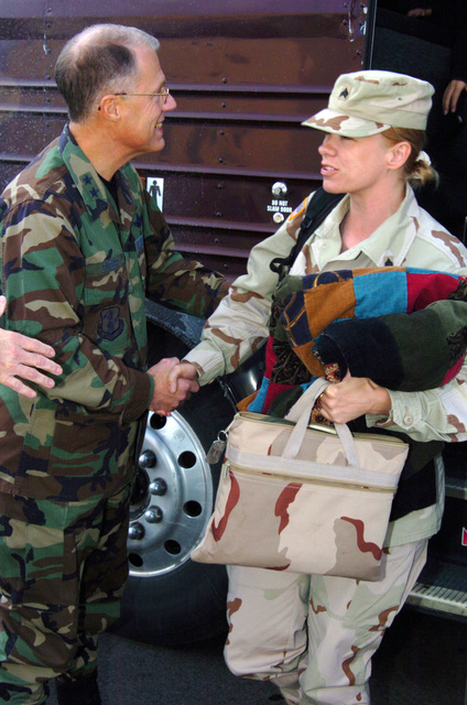 US Army (USA) Major General (MGEN) Thomas Cutler (left), Michigan State Adjutant General, welcomes home a USA Sergeant (SGT) from the 263rd Personnel Services Detachment, Michigan Army National Guard (MIARNG), as she arrives home at Lansing, Michigan (MI), from a one-year deployment to Iraq, in support of Operation IRAQI FREEDOM. (A3695)