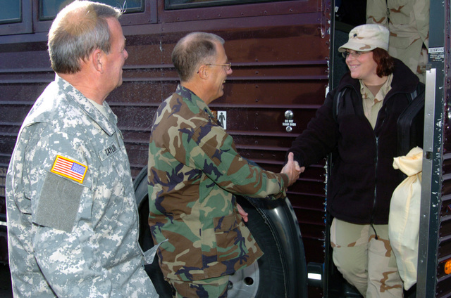 US Army (USA) Soldiers assigned to the 263rd Personnel Services Detachment, Michigan Army National Guard (MIARNG), are meet by high-ranking officials as they arrive at their home in Lansing, Michigan (MI), returning home from a one-year deployment to Iraq, in support of Operation IRAQI FREEDOM. Pictured left-to-right: US Army (USA) Brigadier General (BGEN) Robert V. Taylor (left), Assistant Adjutant General for the Army; USA Major General (MGEN) Thomas Cutler, Michigan State Adjutant General, and USA SPECIALIST (SPC) Michelle Carvalho, 263rd Personnel Services Detachment. (A3695)