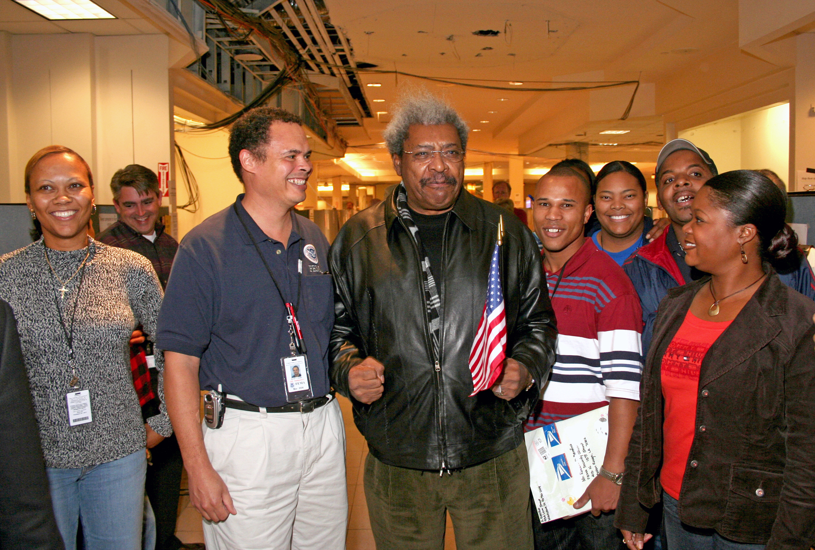 [Hurricane Katrina/Hurricane Rita] Baton Rouge, LA  November 17, 2005 - Boxing promoter Don King makes a surprise visit to FEMA's Louisiana Joint Field Office to rally the spirits of relief workers who have been working to assist Louisianans hurt by hurricanes Katrina and Rita.  His rhyming phrases of encouragment provided a much-needed break.  Photo by Greg Henshall / FEMA