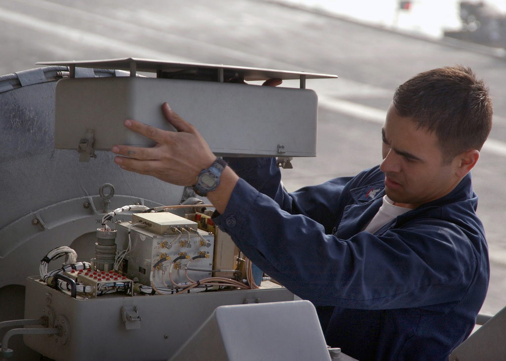 US Navy (USN) Electronics Technician Third Class (ET3) Urban Garcia performs maintenance on the AN/SPN-46 Precision Approach Radar system aboard the USN Nimitz Class Aircraft Carrier USS THEODORE ROOSEVELT (CVN 71). The ROOSEVELT and embarked Carrier Air Wing Eight (CVW-8) are currently underway in the Persian Gulf supporting Operation STEEL CURTAIN, a joint US-Iraqi military offensive aimed at preventing cells of Al Qaeda from entering Iraq through the Syrian border