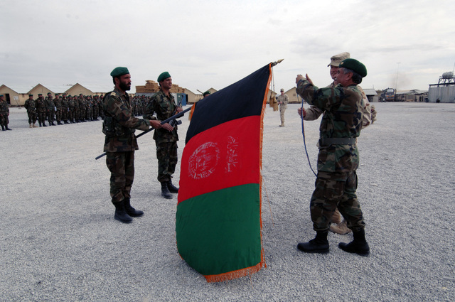 MAJ. Gen. Amed Muslim (right) of the Afghan National Army (ANA) puts a new streamer to the flag of Afghanistan during the closing ceremony of Atal Wali training exercise, Nov. 20, 2005 at the Shir Zai Compound, Kandahar, Afghanistan. (U.S. Army PHOTO by SPC. Leslie Angulo) (Released)