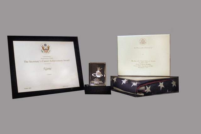 [Assignment: 59-CF-DS-25326-05] Closeups, for State Magazine, of official gifts bestowed during Department retirement ceremonies [Photographer: Ann Thomas--State] [59-CF-DS-25326-05_Retirement_Gifts.jpg]