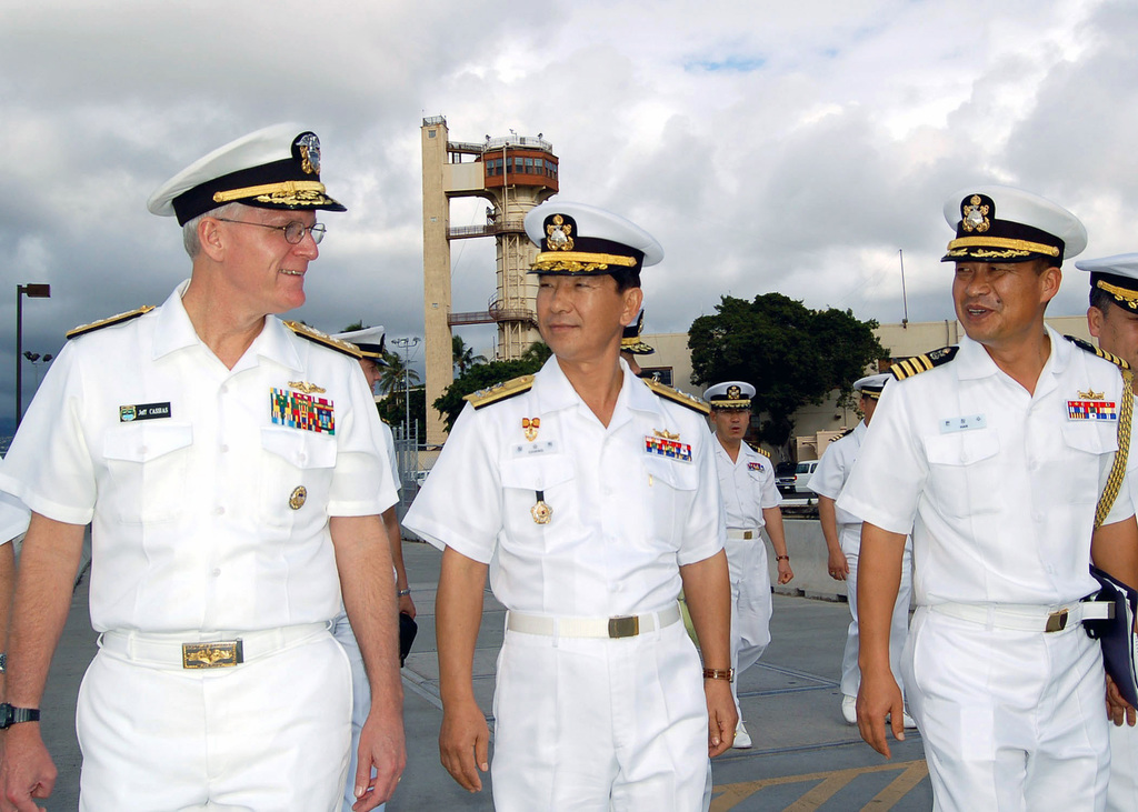 US Navy (USN) Rear Admiral (RADM) (upper half) Jeffrey Cassias, Commander Submarine Force, and US Pacific Fleet meets with Rear Admiral (RADM) Seung Hak Chang (center), Deputy Commander of Republic of Korea (ROK) Navy, and ROK Captain (CAPT) Man (right), ROKs newest class of flag officer. The Koreans just finished touring the USN Los Angeles Class Attack Submarine USS KEY WEST (SSN 722) [not shown]