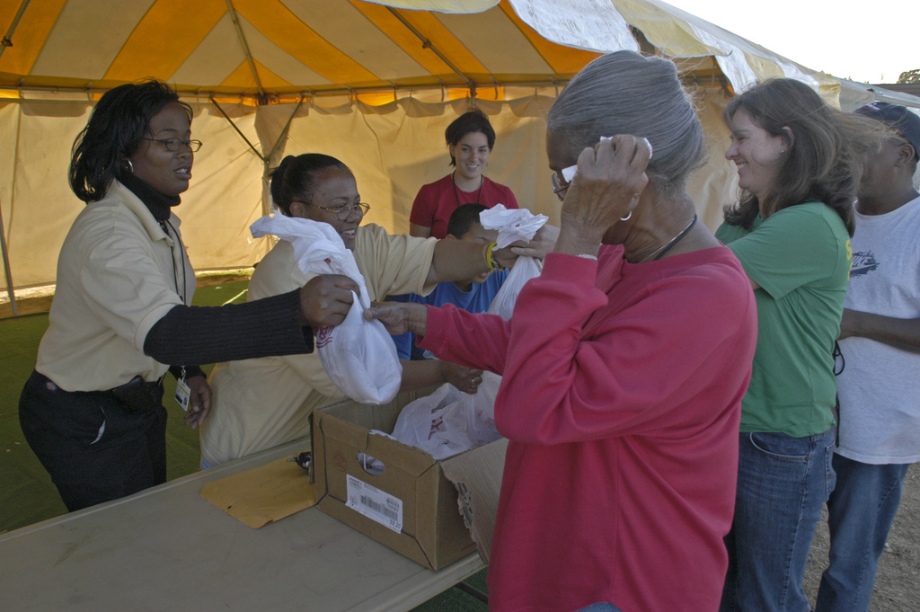 [Hurricane Katrina/Hurricane Rita] Baton Rouge, LA, 11-23-05 -- Thanksgiving Chickens and Hams are handed out to evacuee's at the Baker FEMA Family Tralier Park by park staff.  MARVIN NAUMAN/FEMA photo