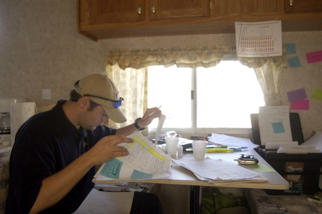 [Hurricane Katrina] D'Iberville, MS, November 24, 2005 -- A FEMA contractor reviews paperwork in anticipation of releasing a new mobile home to hurricane evacuees on Thanksgiving day.  Patsy Lynch/FEMA