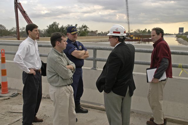 [Hurricane Katrina] New Orleans, LA, 12-02-05 -- Dan Hitchings is the Director Task Force Hope, David Berger is a Local Real Estate Developer, Steve McMillan is a Deputy for Karl Rove,  Vice Admiral Thad Allen (USCG) Federal Coordinating Office and Al Hubbard is a Presidents Assistant on Econonics talk about Levee repairs.  Al Hubbard was touring the damaged Hurricane Katrina area to get a better idea of the maginatude of the disaster.  MARVIN NAUMAN/FEMA photo