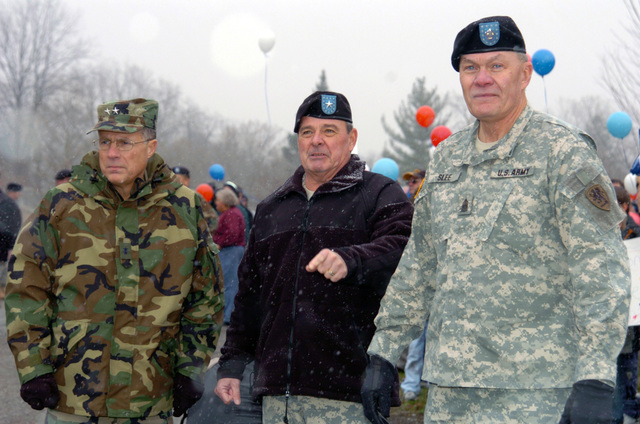 The US Army (USA) Command Element for 1ST Battalion, 119th Field Artillery (1-119th FA), Michigan Army National Guard (MIARNG), awaits the return of their Soldiers re-deploying home to Lansing, Michigan (MI), following a one year tour of duty in Iraq. Pictured left-to-right: USA Major General (MGEN) Thomas Cutler, Michigan State Adjutant; USA Brigadier General (BGEN) Robert Taylor; and USA Command Sergeant Major (CSM) Kenneth Slee, 1-119th FA. (A3596)