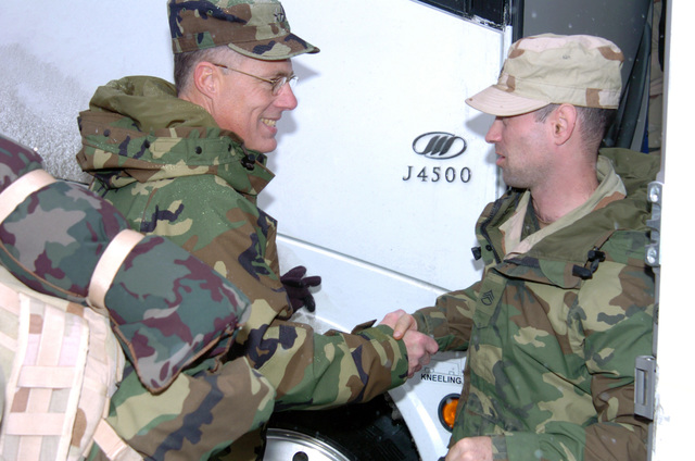 US Army (USA) Major General (MGEN) Thomas Cutler (left), Michigan State Adjutant; greets a USA Soldiers assigned to Headquarters (HQ), 1ST Battalion, 119th Field Artillery (1-119th FA), Michigan Army National Guard (MIARNG), arriving by bus at the armory at Lansing, Michigan (MI), returning home following a one year tour of duty in Iraq. (A3596)